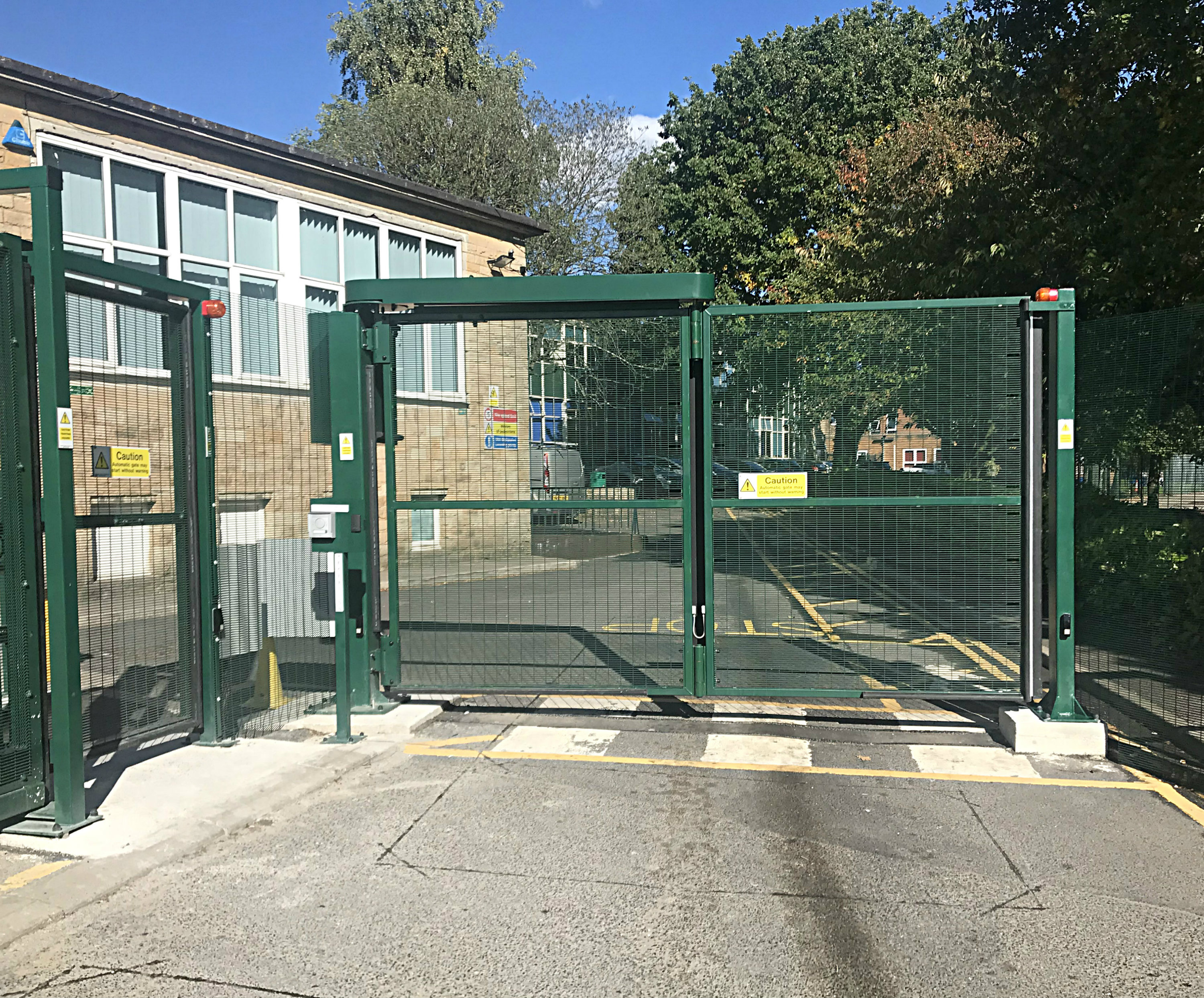 Security Solutions Cannon Slade Automatic Bifolding Gate